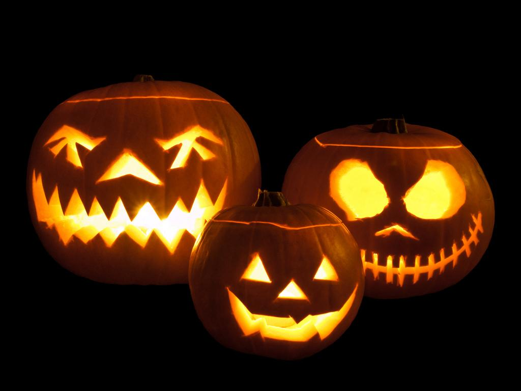 Jack-o'-lanterns carved from pumpkins and lit with tea lights