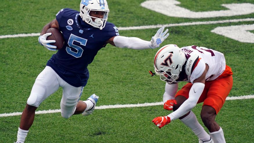 Newsome evading a Virginia Tech defender.