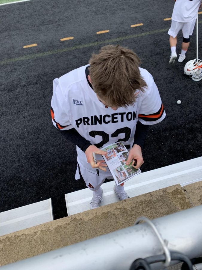 Former Princeton and current Duke attackman Michael Sowers signing autographs for fans after a game in 2020.